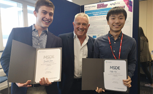 ​​​​​​​​​Daniele Visco and Griffin Gui being presented their prizes for best MRes posters by Prof. Julian Eastoe